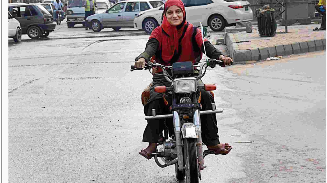 """A woman Biker"" by Suzzanna Javed"